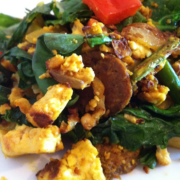 this tofu scramble has sundried tomato tofurkey sausages in it as well as spinach, basil, and some other equally awesome things.
