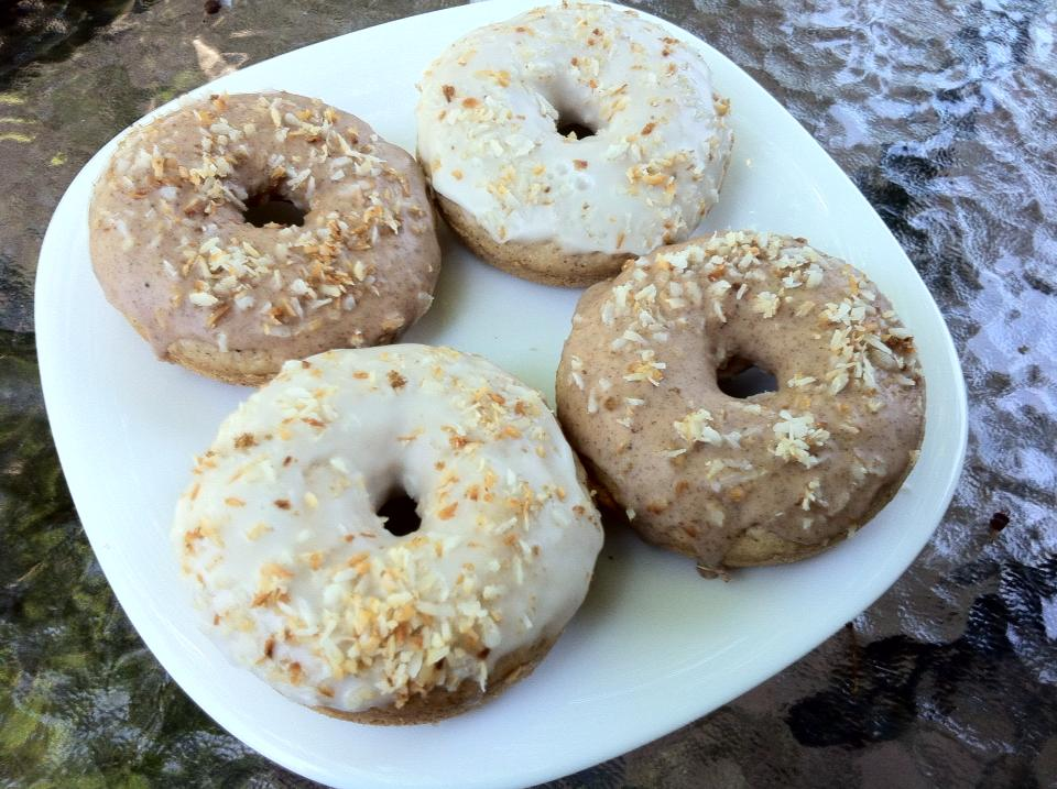 Vanilla spice donuts, glazed, with toasted coconut on top.