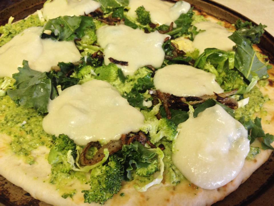 cashew mozza, pesto, caramelized onions, broccoli, kale!